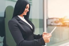 Successful business woman working with tablet in an urban setting Royalty Free Stock Photo