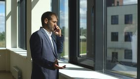 Young successful businessman arguing on the phone stock footage
