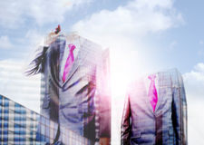 Young successful businessman on a city background Stock Images