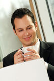 Young successful businessman is drinking coffee Stock Images