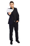 Young successful businessman. Young businessman gives blank paper stock photos