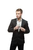 Young successful businessman holding money Stock Image