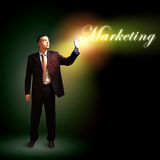 Businessman with light shining Stock Images