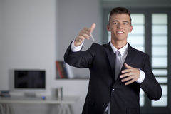 Young successful businessman holding a stick Royalty Free Stock Photo