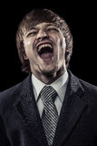 Young successful businessman laughing hard Stock Photos