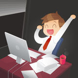 Young successful businessman in the office at night Stock Images