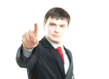 Young successful businessman pressing imaginary button Royalty Free Stock Photo
