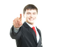 Young successful businessman pressing imaginary button Stock Image