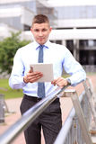 Young successful businessman with tablet outdoors. Young successful businessman with modern tablet outdoors Stock Images