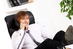 Young and successful businessman talking by phone Stock Images