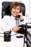 Young and successful businessman talking by phone Royalty Free Stock Photo