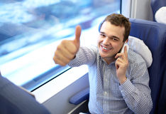 Young successful businessman in the train. Royalty Free Stock Image