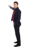 Young successful businessman on white background. Young businessman shows his hand back royalty free stock photo