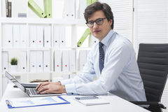 Young successful businessman in white office Royalty Free Stock Photography