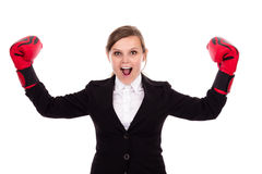 Young successful businesswoman celebrating wearing boxing gloves Stock Photos