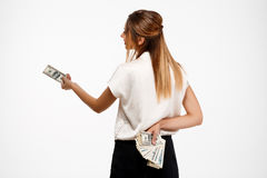 young successful businesswoman holding money over white background. Royalty Free Stock Images