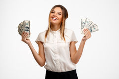 young successful businesswoman holding money over white background. Royalty Free Stock Image