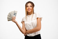 young successful businesswoman holding money over white background. Stock Photos