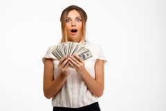 young successful businesswoman holding money over white background. Stock Image