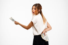 young successful businesswoman holding money over white background. Royalty Free Stock Photos