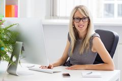 Young successful businesswoman in the office Stock Images
