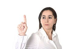 Young successful businesswoman pointing with finger to copy space Stock Image