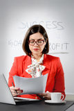 Young successful businesswoman reading a document Stock Images