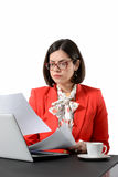 Young successful businesswoman reading a document Stock Image