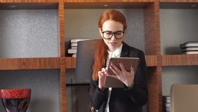 Young successful businesswoman using tablet at home living room home office. Young successful businesswoman using tablet at home living room home office stock video footage