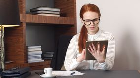 Young successful businesswoman using tablet at home living room home office. Young successful businesswoman using tablet at home living room home office stock video