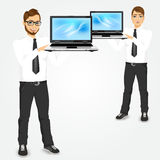 Young successful career man holding laptop Stock Image