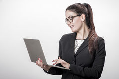 Young successful career woman holds her laptop Stock Photography