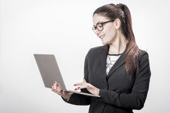 Young successful career woman holds her laptop Stock Images
