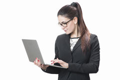 Young successful career woman holds her laptop Stock Photo