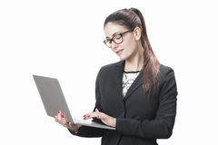 Young successful career woman holds her laptop Royalty Free Stock Photos
