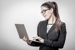 Young successful career woman holds her laptop Stock Image