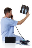Young successful caucasian man doctor, x-ray Royalty Free Stock Image