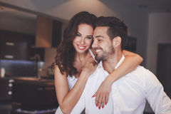 Young successful couple smiling, woman embrace man Stock Photos