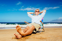 Young Successful Entrepreneur Relaxing on the Beach Stock Photo