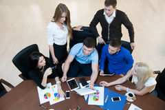 Young successful entrepreneurs at a business meeting. Stock Photos