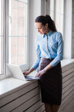 Young successful happy smiling business woman on laptop Stock Photos