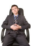 Young successful man in blueshirt and tie. Young successful man in blue shirt and tie sitting on the chair Royalty Free Stock Photo