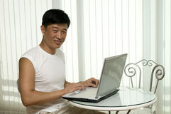 The young successful man   with the computer Royalty Free Stock Photography