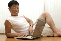 The young successful man   with the computer sits Stock Image