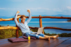 Young successful man is sitting with laptop Stock Image