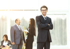Young successful manager in the background business team in the office Royalty Free Stock Image