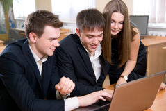 Young, successful people at office Royalty Free Stock Images