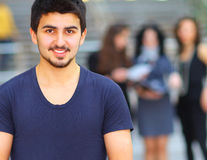 Young successful student. At the University in the background of his classmates Royalty Free Stock Image