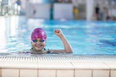 Young and successful swimmers pose Royalty Free Stock Image