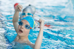 Young and successful swimmers pose Stock Images